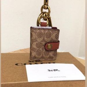 Coach PICTURE FRAME BAG CHARM IN SIGNATURE…